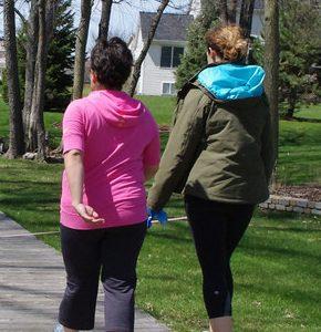 Photo of women walking in a park. Source: Jellaluna, Flickr