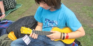 Photo of boy playing the ukulele. Source: SteveR-, Flickr.