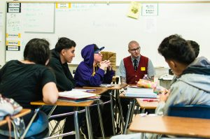 Photo of Ryan Gattis with teens from Firebaugh High School. Source: ryangattis.com