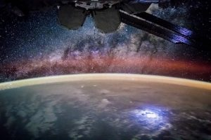 Color photograph of stars, earth, and partial view of International Space Station. Source: NASAl M. Justin Wilkinson, Texas State U., Jacobs Contract at NASA-JSC and Mark Matney, NASA-JSC