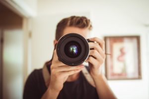 Teen holding camera. Source: Andrew Weber, Pexels.