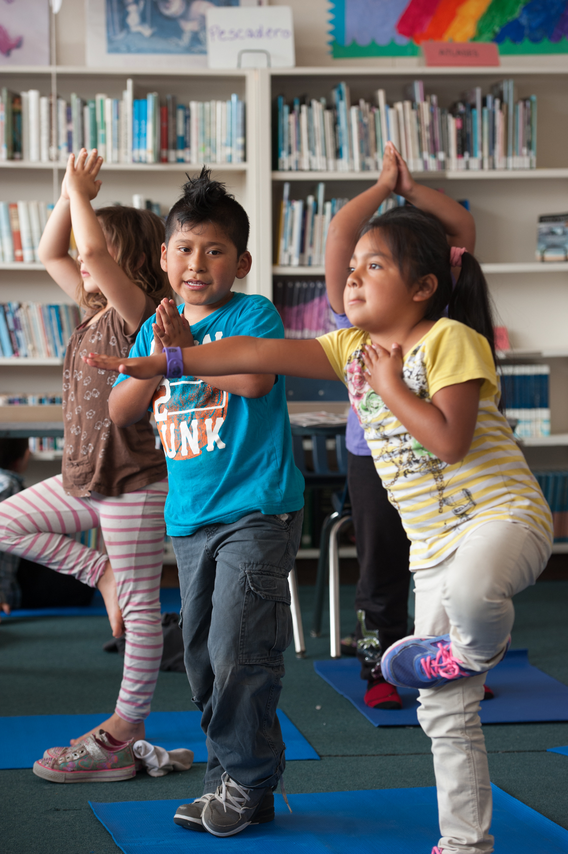 Children participating in yoga at the Library.