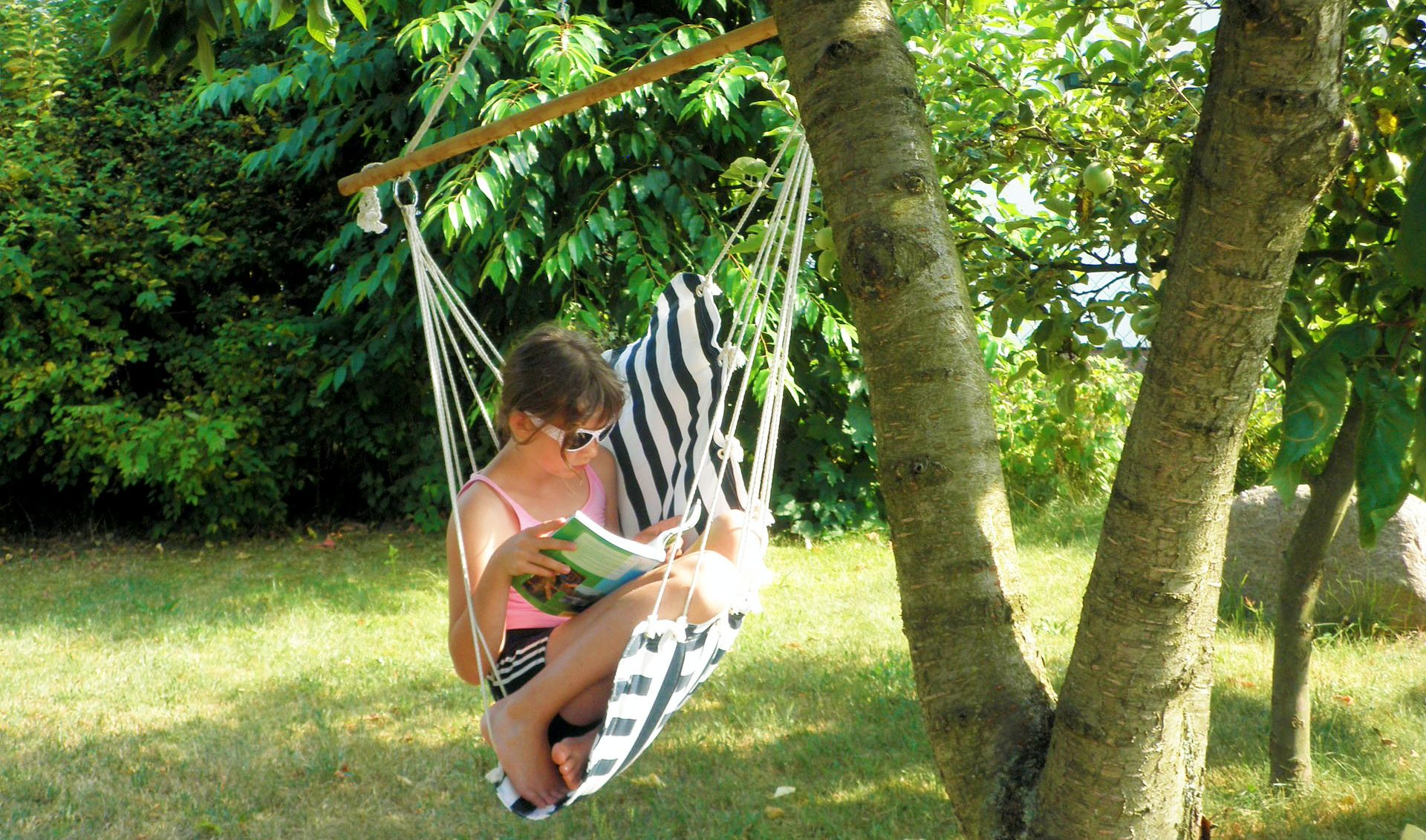 Girl reading on hammock.