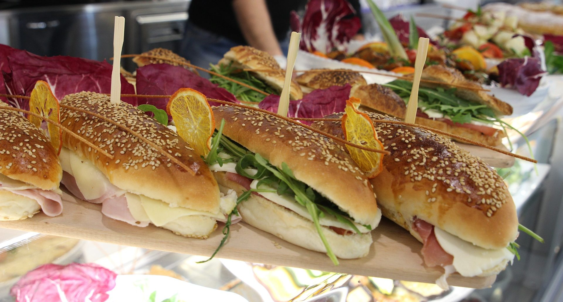 Row of sandwiches at a deli.