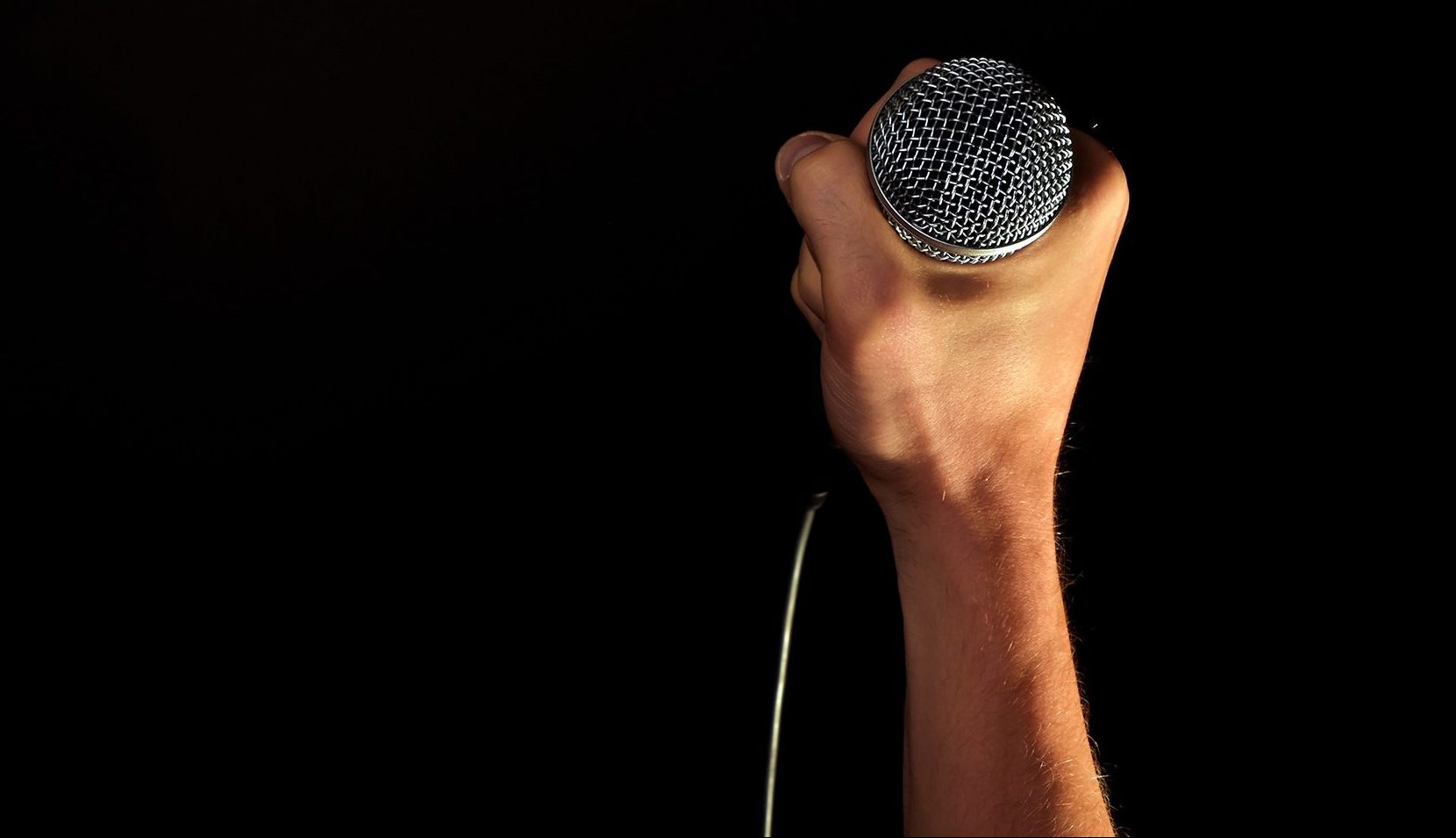Hand with mic.