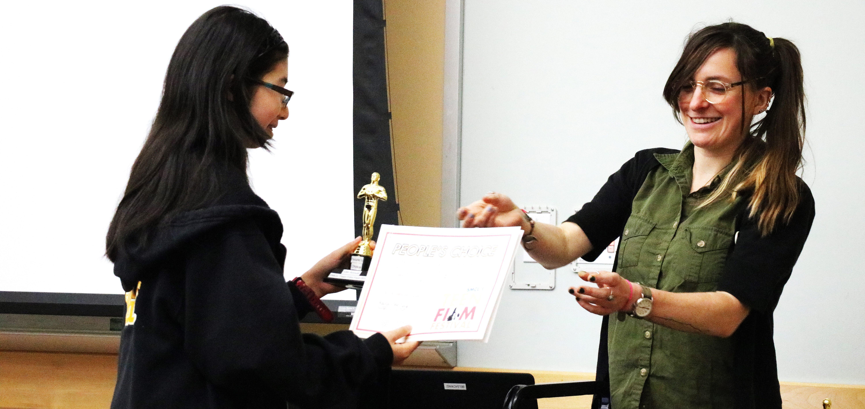 Teen receiving an award at the 10th Annual Teen Film Fest.