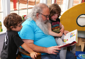 Family reading at the library.